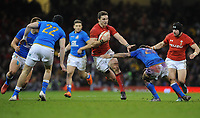 Wales George North palms away Italy&rsquo;s Jayden Hayward<br /> <br /> Photographer Ian Cook/CameraSport<br /> <br /> 2018 NatWest Six Nations Championship - Wales v Italy - Sunday 11th March 2018 - Principality Stadium - Cardiff<br /> <br /> World Copyright &copy; 2018 CameraSport. All rights reserved. 43 Linden Ave. Countesthorpe. Leicester. England. LE8 5PG - Tel: +44 (0) 116 277 4147 - admin@camerasport.com - www.camerasport.com