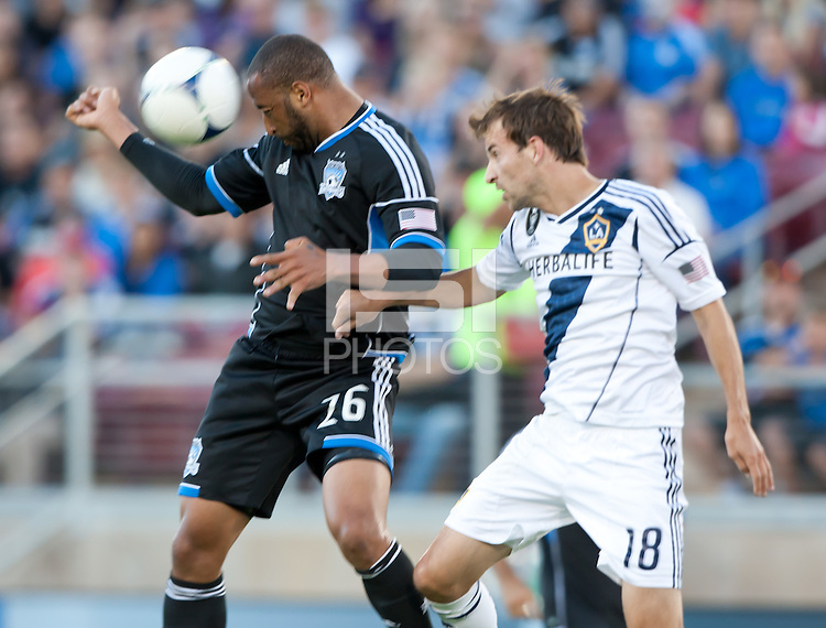Stanford, California - Saturday June 30, 2012: Victor Bernardez heads the ball away from Mike Maggie during a game at Stanford Stadium, Stanford, Ca.San Jose Earthquakes defeated Los Angeles Galaxy,  4 to 3