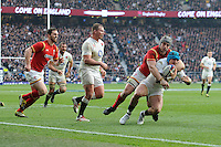 Jack Nowell of England is tackled by Jonathan Davies of Wales during the RBS 6 Nations match between England and Wales at Twickenham Stadium on Saturday 12th March 2016 (Photo: Rob Munro/Stewart Communications)