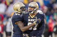 Annapolis, MD - OCT 8, 2016: Navy Midshipmen wide receiver Brandon Colon (87) and Navy Midshipmen wide receiver Taylor Jackson (89) celebrate after his touchdown late in the fourth quarter during game between Houston and Navy at Navy-Marine Corps Memorial Stadium Annapolis, MD. The Midshipmen upset #6 Houston 46-40. (Photo by Phil Peters/Media Images International)