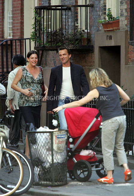 WWW.ACEPIXS.COM . . . . . ..NEW YORK, SEPTEMBER 21, 2004: Very pregnant and happy looking Liv Tyler looks into a stroller with adoration as she strolls in her neighborhood with a friend. Please byline: BRIAN FLANNERY - ACE PICTURES.. . . . . . ..Ace Pictures, Inc:  ..Alecsey Boldeskul (646) 267-6913 ..Philip Vaughan (646) 769-0430..e-mail: info@acepixs.com..web: http://www.acepixs.com