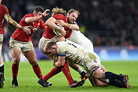 Alun Wyn Jones of Wales is tackled by Sam Underhill of England. Natwest 6 Nations match between England and Wales on February 10, 2018 at Twickenham Stadium in London, England. Photo by: Patrick Khachfe / Onside Images