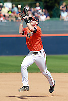 Virginia infielder Branden Cogswell (7) makes a catch during the game against Clemson Sunday at Davenport Field in Charlottesville, VA. Photo/Daily Progress/Andrew Shurtleff