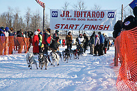 Saturday, February 24th, Knik, Alaska.  Jr. Iditarod musher Daniel Osmar leaves start line on Knik Lake