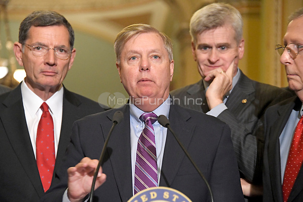 United States Senator Lindsey Graham (Republican of South Carolina) speaks to reporters outside the US Senate Chamber following the Republican weekly luncheon caucus in the US Capitol in Washington, DC on Tuesday, September 19, 2017.  The GOP leadership is advocating for the passage of the Graham-Cassidy Act that would replace parts of the Affordable Care Act (also known as ObamaCare) with block grants for the individual states.  From left to right: US Senator John Barrasso (Republican of Wyoming), Senator Graham, US Senator Bill Cassidy (Republican of Louisiana) and US Senate Majority Leader Mitch McConnell (Republican of Kentucky).<br /> Credit: Ron Sachs / CNP /MediaPunch