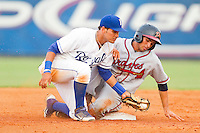 Jose Peraza (4) of the Danville Braves slides into second base ahead of the tag by Burlington Royals shortstop Humberto Arteaga (13) at Burlington Athletic Park on July 18, 2012 in Burlington, North Carolina.  The Royals defeated the Braves 4-3 in 11 innings.  (Brian Westerholt/Four Seam Images)