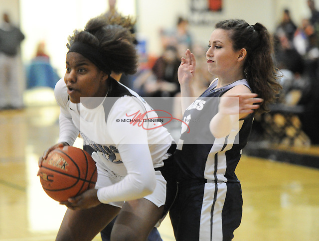 Chugiak's Chastity Horn blows through the defense of the Wolves' Jenna Gelson.  Photo for the Star by Michael Dinneen.