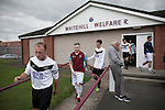 Gala Fairydean Rovers players (in white) walking on to the pitch prior to their team's inaugural match in the Scottish Lowland Football League away to Whitehill Welfare at Ferguson Park. Gala were formed in 2013 by an a re-amalgamation of Gala Fairydean and Gala Rovers, the two clubs having separated in 1908 and Gala's Netherdale ground in Galashiels in the Scottish Borders had one of only two stands designated as listed football stands in Scotland. Whitehill won the match, the first-ever in the newly-formed Lowland League by 4 goals to 2.