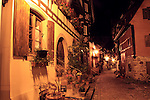 Town streets at night in Eguisheim, Alsace, France.