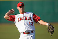 Brett Lawrie #13 of Team Canada warms up in the outfield prior to playing against Team USA at the USA Baseball National Training Center, September 4, 2009 in Cary, North Carolina.  (Photo by Brian Westerholt / Four Seam Images)