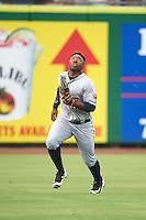 Lakeland Flying Tigers left fielder Christin Stewart (20) chasing down a fly ball during a game against the Clearwater Threshers on August 5, 2016 at Bright House Field in Clearwater, Florida.  Clearwater defeated Lakeland 3-2.  (Mike Janes/Four Seam Images)