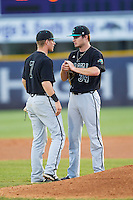 Zach Remillard (7) of the Coastal Carolina Chanticleers had a chat on the mound with starting pitcher Cole Schaefer (34) during the game against the High Point Panthers at Willard Stadium on March 15, 2014 in High Point, North Carolina.  The Panthers defeated the Chanticleers 11-8 in game two of a double-header.  (Brian Westerholt/Four Seam Images)