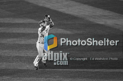 1 April 2013: Washington Nationals outfielder Bryce Harper pulls in a Greg Dobbs fly ball during the Nationals' Opening Day Game against the Miami Marlins at Nationals Park in Washington, DC. The Nationals shut out the Marlins 2-0 to launch the 2013 season. Mandatory Credit: Ed Wolfstein Photo *** RAW (NEF) Image File Available ***