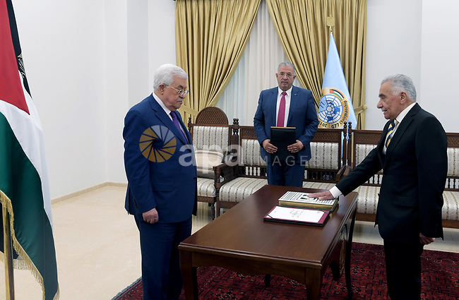 Mr. Issa Abu Sharar sworn in as the legal oath In front of Palestinian President Mahmoud Abbas, as President of the Higher Judicial Council in the West Bank city of Ramallah on July 18, 2019. Photo by Thaer Ganaim