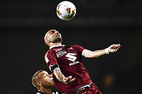23rd June 2020; Turin, Italy; Serie A football, Torino versus Udinese;  Simone Zaza climbs high to win the header over Sebastien De Maio