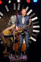 Joshua Redman adjust his tenor saxophone between songs with the Ethan Iverson Trio during the Monk @ 100 festival at the Durham Fruit and Produce Company in Durham, NC Wednesday, October 25, 2017. (Justin Cook for The New York Times)