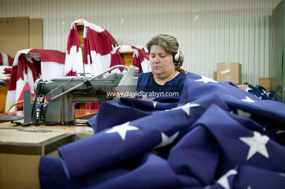 21 June 2005 - Oaks, PA - Karen Hipple works on fields - the starred part of an American flag - at the Annin & Co. flag manufacturing plant in Oaks, PA.