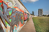 Section of the Berlin Wall covered in graffiti, part of the East Side Gallery, a 1.3km long section of the Wall on Muhlenstrasse painted in 1990 on its Eastern side by 105 artists from around the world, Berlin, Germany. Picture by Manuel Cohen