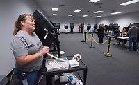 NWA Democrat-Gazette/BEN GOFF @NWABENGOFF<br /> Kim Dennison, election coordinator, waits to give 'I voted' stickers to early voters Saturday, Nov. 3, 2018, at the Benton County Election Commission office in Rogers. Early voting continues through Monday for Tuesday's general election.