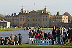 Badminton Horse Trials Gloucestershire UK.Badminton House and Lake with spectators enjoying a drink at the end of the horse trials.