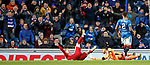 Gary Mackay-Steven takes a dramatic tumble in the box - much to the mirth of the Rangers fans behind the goal