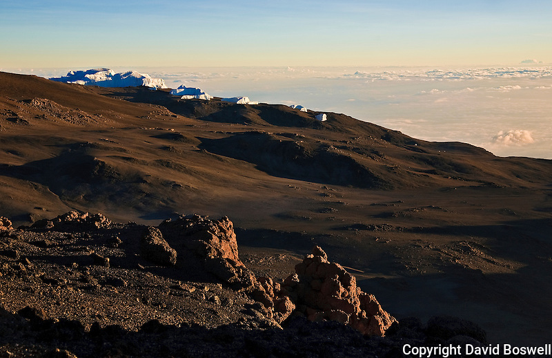 The moonscape of Kilimanjaro's crater on Kibo, with the diminishing Eastern Icefield in the background.