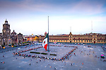 People gather in the Zocalo to watch members of the army lower the Mexican flag, a daily late afternoon ritual in Mexico City.
