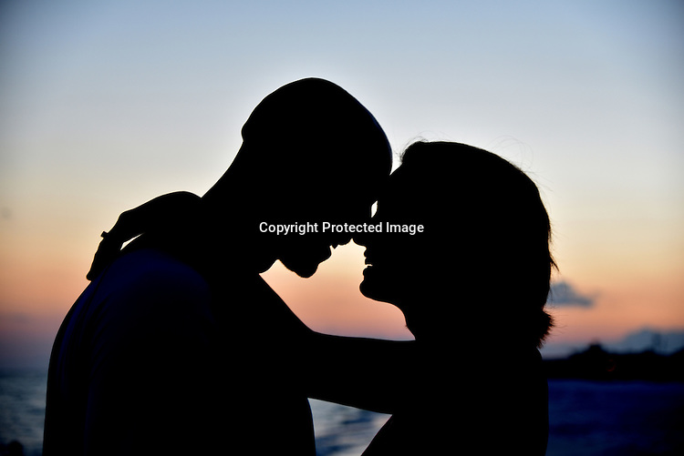 Couple laughing at sunset