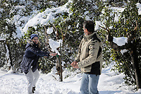 Pictured: A couple snow fights in the Ekali area of Athens, Greece. Tuesday 08 January 2018<br /> Re: Heavy snowfall has affected most parts of Greece.