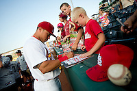 Kolten Wong (4) of the Springfield Cardinals signs autographs for young fans prior to a game against the Arkansas Travelers at Hammons Field on July 24, 2012 in Springfield, Missouri. (David Welker/Four Seam Images)