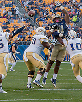 Pitt defensive lineman Darryl Render (91) tries to block a pass. The Georgia Tech Yellow Jackets defeated the Pitt Panthers 56-28 at Heinz Field, Pittsburgh Pennsylvania on October 25, 2014.