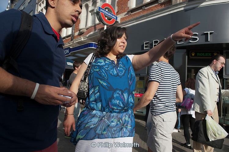 Tourists in Oxford Street, London.