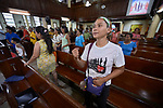 Methche Bayan dances while she sings during worship at Knox United Methodist Church in Manila, Philippines. The service is part of a weekday program where the church opens up to poor people in the neighborhood, offering showers, food, fellowship, and an opportunity to worship together.
