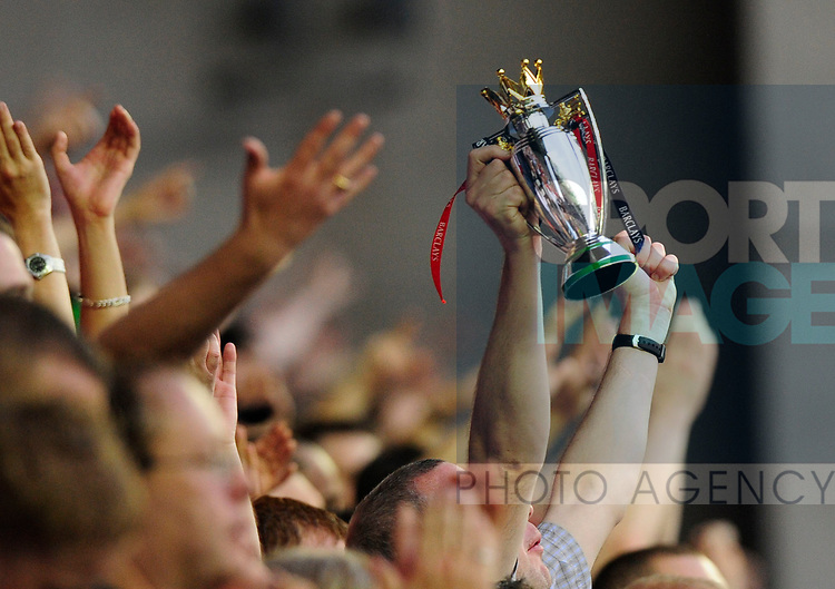 Manchester United fans with a toy Premier League Trophy during the Premier League match at The JJB Stadium, Wigan. Picture date 11th May 2008. Picture credit should read: Simon Bellis/Sportimage