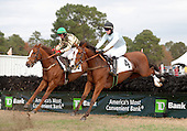 Sergeant Karakorum (green cap) wins the opening contest at Camden, a maiden event. That's Blythe Miller Davies' Eat Cake alongside.