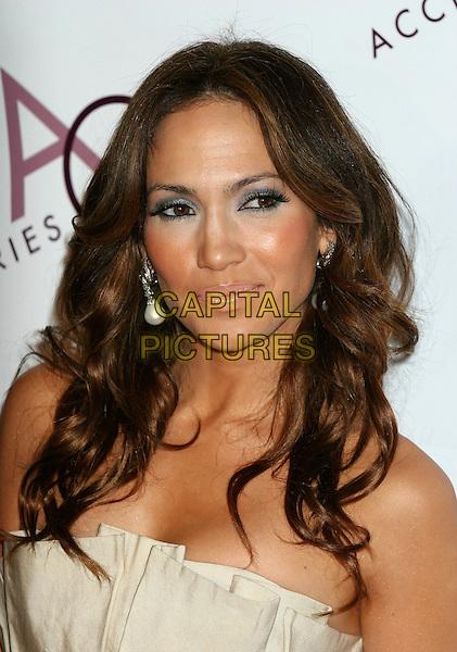 JENNIFER LOPEZ.Arrivals at the 10th Annual Ace Awards at Cipriani, New York, NYC, USA, October 30th 2006..portrait headshot grey blue eyeshadow black eyeliner bronzer pale pink lipgloss earrings make-up .Ref: IW.www.capitalpictures.com.sales@capitalpictures.com.©Ian Wilson/Capital Pictures
