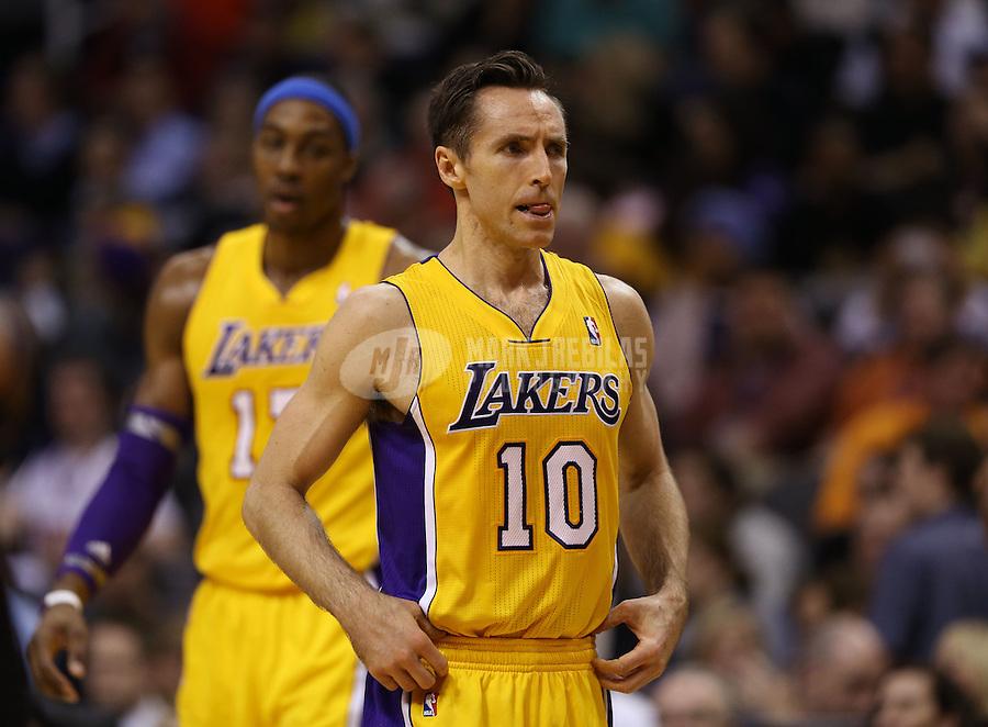 Jan. 30, 2013; Phoenix, AZ, USA: Los Angeles Lakers guard Steve Nash (10) and center Dwight Howard against the Phoenix Suns at the US Airways Center. Mandatory Credit: Mark J. Rebilas-