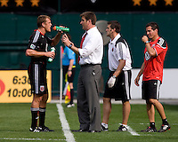 D.C. United head coach Curt Onalfo talks to forward (7) Adam Cristman at RFK Stadium in Washington, DC.  The New York Red Bulls defeated D.CC United, 2-0.