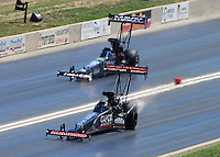 Jul, 21, 2012; Morrison, CO, USA: NHRA top fuel dragster driver Steve Torrence (near lane) alongside Brandon Bernstein during qualifying for the Mile High Nationals at Bandimere Speedway. Mandatory Credit: Mark J. Rebilas-