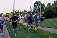 Led by Meb Keflezghi, more than 200 runners take to the sidewalk, grass, and streets to run during the Run with Meb event sponsored by Fleet Feet St. Louis, in Des Peres, MO. Wednesday, September 3, 2014. The Olympic medalist and New York and Boston Marathon champion threw out the first-pitch at the St. Louis Cardinals game earlier in the day.