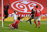 24th May 2020, Opel Arena, Mainz, Rhineland-Palatinate, Germany; Bundesliga football; Mainz 05 versus RB Leipzig; Timo Werner (RB Leipzig) jumps to clear the shot as Florian Mueller (FSV Mainz 05) and Jean-Paul Boeatuis (FSV Mainz 05) try to stop the shot from Christopher Nkunku (RB Leipzig)