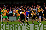 Johnny Buckley and Shane Myers of Dr Crokes tries to hold off Gneeveguilla's Donie O'Connor in Gneeveguilla last Sunday evening in round 1 of the Garvey's Supervalue County Senior Championship.