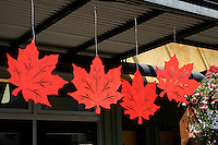 Canadian red maple leaf decorations outside a shop on Granville Island, Vancouver, BC, Canada