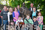 Johnny OLearys grandchildren gather at his monument in Killarney last Saturday. .
