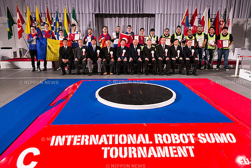 FUJISOFT oganizares pose for the cameras with the winners of the International Robot Sumo Tournament 2015, in the Ryogoku Sumo Hall (Ryogoku Kokugikan) on December 13, 2015. The annual competition brings the winners from 14 robot sumo tournaments held globally, plus the Japanese winners of the All Japan Robot-Sumo National Tournament and All Japan Robot-Sumo Tournament (High-School class) to fight for the world's first place in two divisions: autonomous and radio controlled. The international tournament is part of the All Japan Robot-Sumo Tournament which has been held in various countries since 1989. According to the rules the robot wrestler loses when the robot is forced outside the sumo ring, simulating a traditional sumo fight. (Photo by Rodrigo Reyes Marin/AFLO)