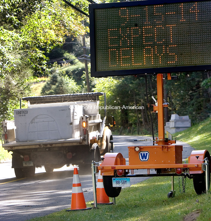 SOUTHBURY CT. 15 September 2014-091514SV01-A road improvement project began on Peter Road in Southbury Monday. The work will run through the end of October, and it involves grading and repaving. New curbs and driveway aprons will also be installed. <br /> Steven Valenti Republican-American
