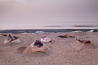 Illegal refugees sleeping on the beach. About 100 non-registered refugees arrive from Somalia every day. They are trying either to find work in Djibouti or to cross the Red Sea to Yemen, on way to their dream destination: Dubai. ..The geostrategical and geopolitical importance of the Republic of Djibouti, located on the Horn of Africa, by the Red Sea and the Gulf of Aden, and bordered by Eritrea, Ethiopia and Somalia.