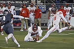 New Mexico's Tyson Dyer (96) holds as Andrew Shelley (94) kicks a field goal against Nevada in the first half of an NCAA college football game in Reno, Nev., Saturday, Nov. 2, 2019. (AP Photo/Tom R. Smedes)