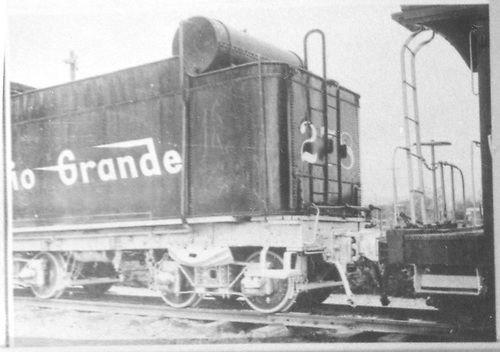 Detail of tender left-side rear.  Coupled to a caboose.<br /> D&amp;RGW