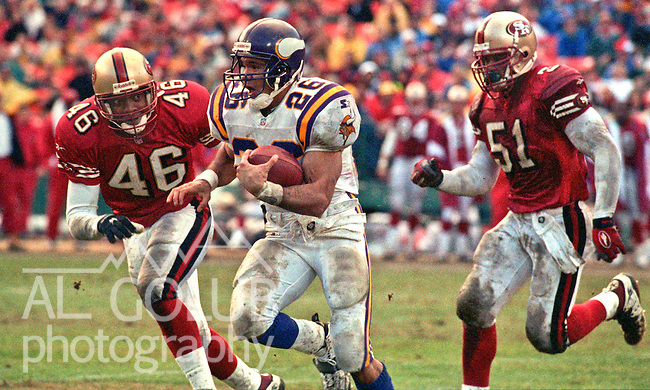 San Francisco 49ers vs. Minnesota Vikings at Candlestick Park Sunday, December 7, 1997.  49ers beat Vikings  28-17.  San Francisco 49ers defensive back Tim McDonald (46) and linebacker Ken Norton (51) chase Minnesota Vikings running back Robert Smith (26).
